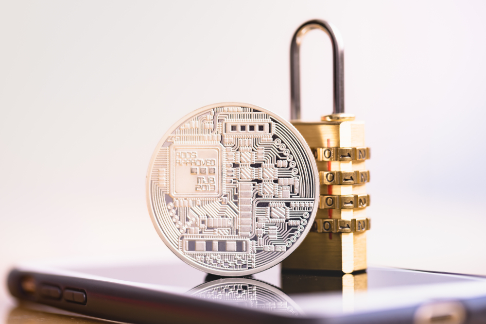 Cryptocurrency,With,Padlock,Lying,On,Smart,Phone.,Bitcoin,Security.,Digital