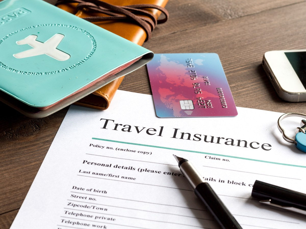 Concept,Booking,Travel,Insurance,On,Wooden,Background